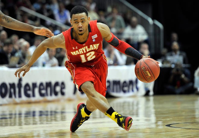 Maryland Terrapins guard Terrell Stoglin (12) drives against the North Carolina Tar Heels during the first half of the quarter-finals of the 2012 ACC Men's Basketball Tournament at Philips Arena.