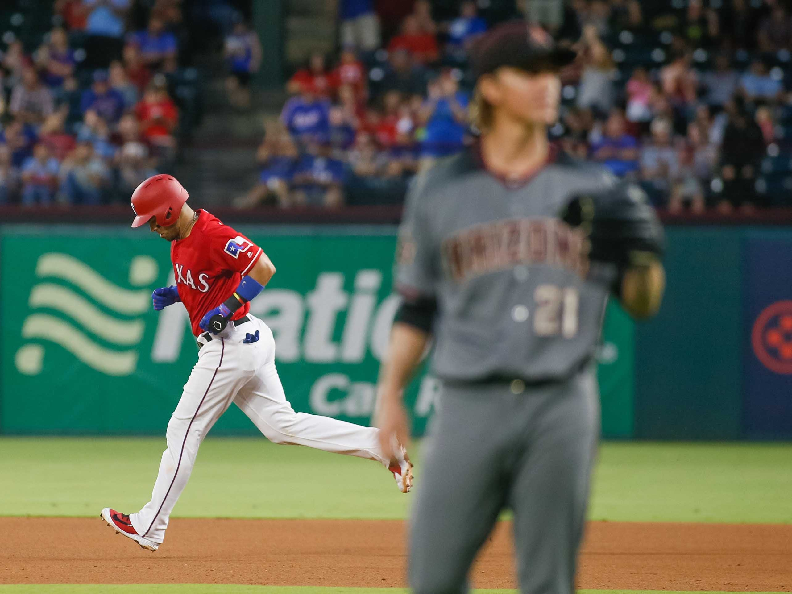 Aug 13, 2018; Arlington, TX, USA; Texas Rangers catcher Robinson Chirinos (61) rounds the bases after hitting a three run homerun off Arizona Diamondbacks starting pitcher Zack Greinke (21) at Globe Life Park in Arlington. Mandatory Credit: Ray Carlin-USA TODAY Sports
