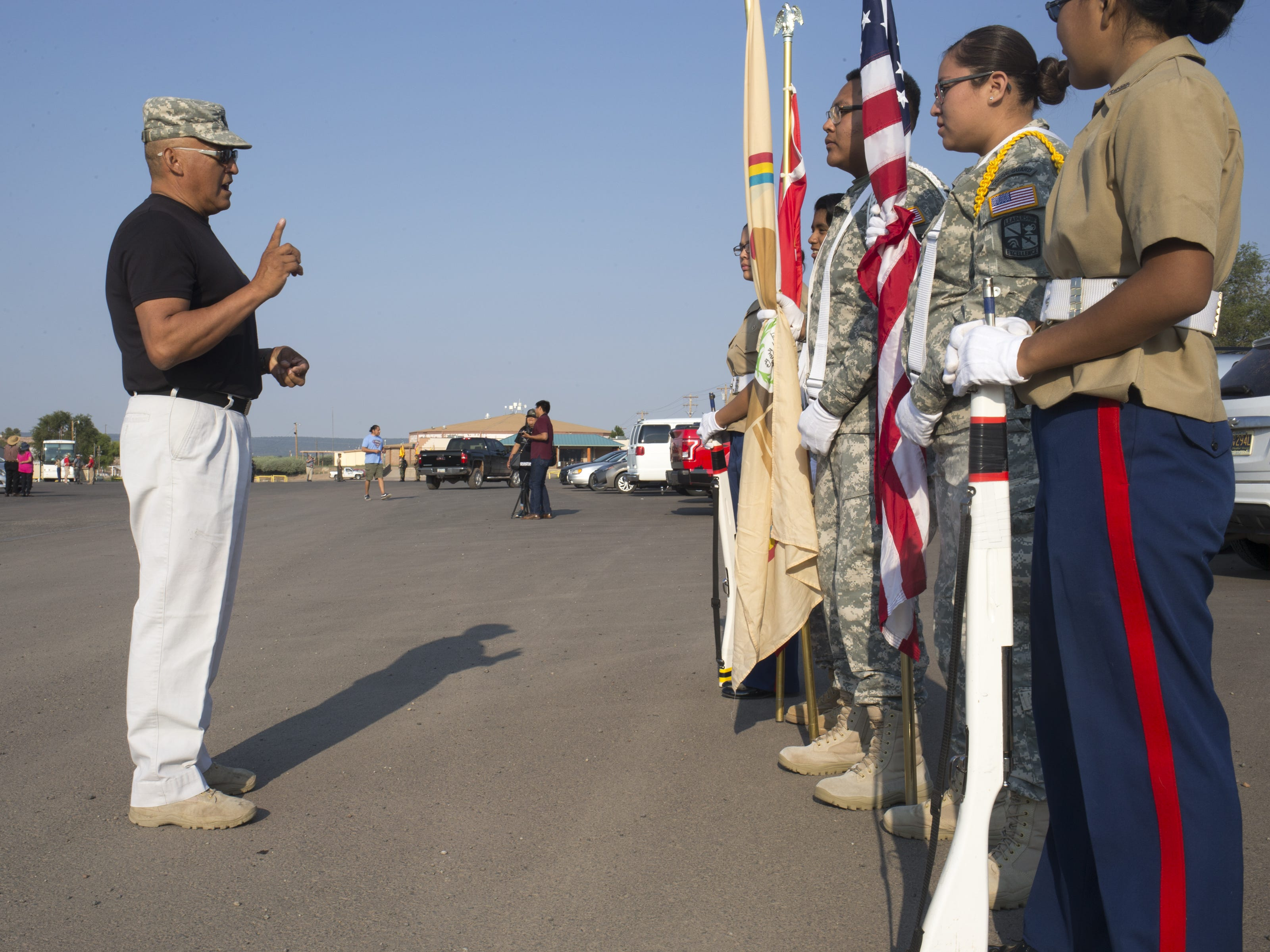 David McLaughlin instructs the Tohatchi ROTC unit, August 13, 2018, before the start of the Navajo Nation Code Talkers Day parade on Aug. 14, 2018, at the Navajo Nation Fairgrounds in Window Rock.