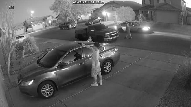 Surveillance footage of suspect pointing gun at vehicle in Phoenix