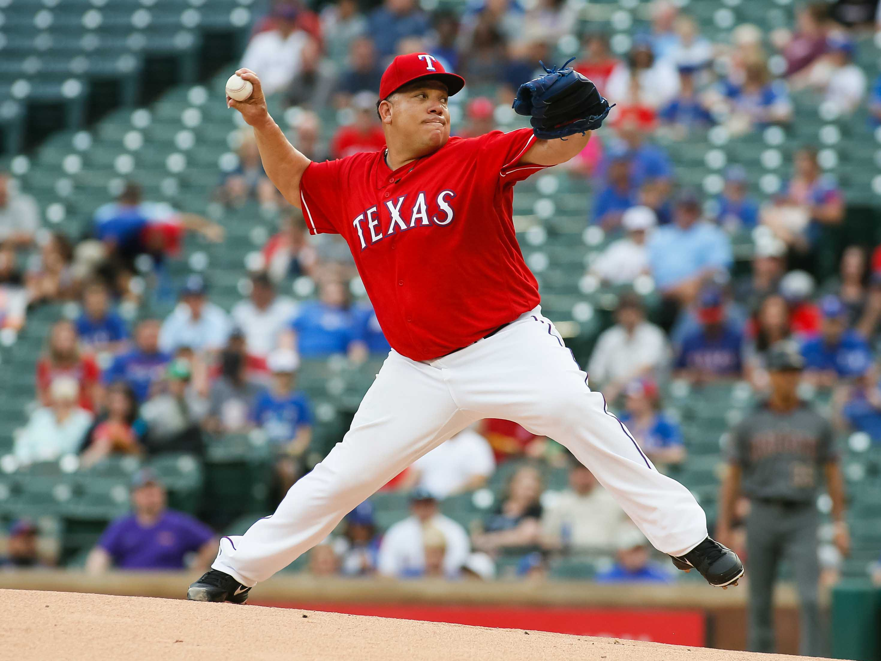 Aug 13, 2018; Arlington, TX, USA; Texas Rangers starting pitcher Bartolo Colon (40) pitches the ball in the first inning against the Arizona Diamondbacks at Globe Life Park in Arlington. Mandatory Credit: Ray Carlin-USA TODAY Sports