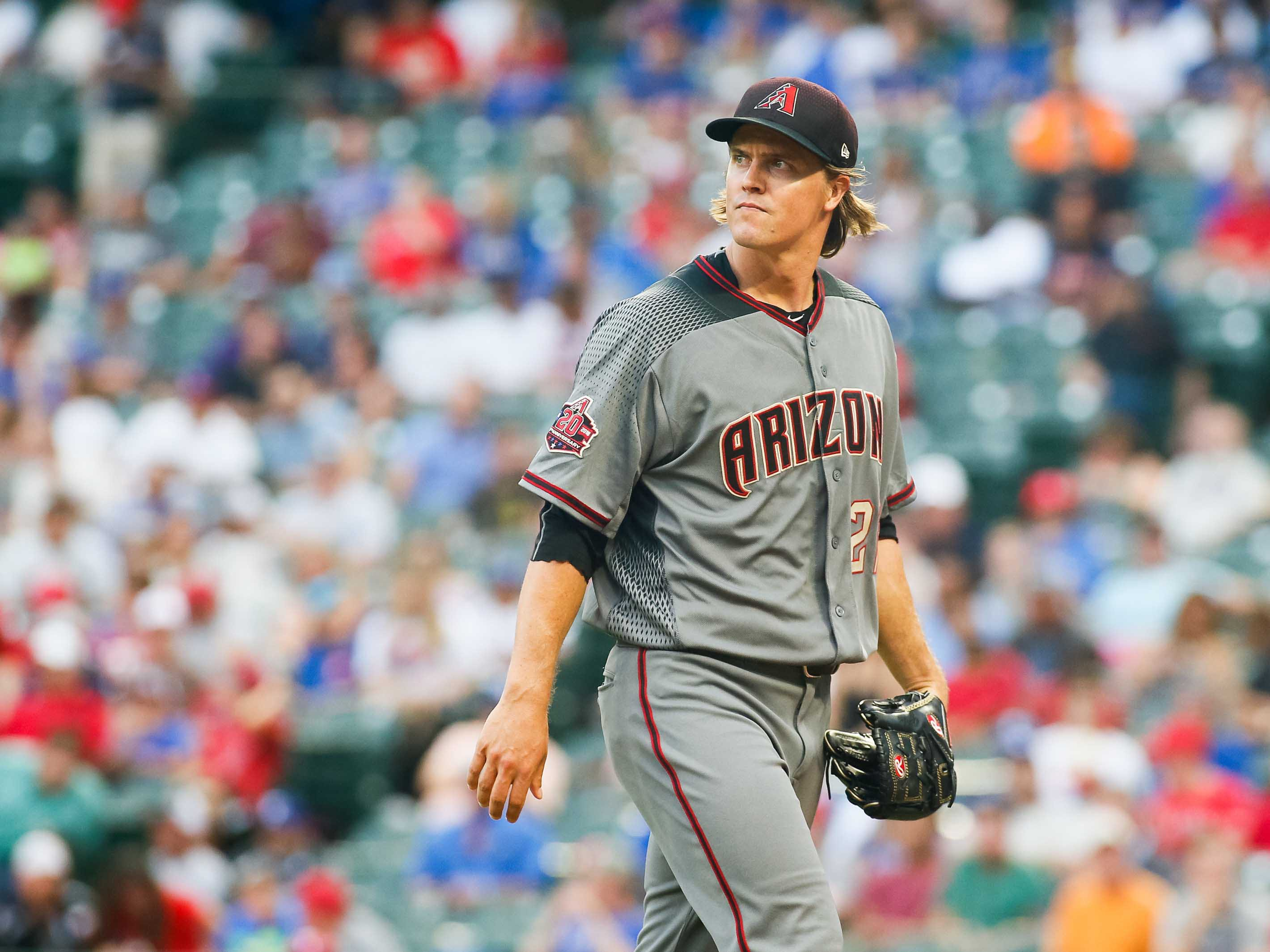 Aug 13, 2018; Arlington, TX, USA; Arizona Diamondbacks starting pitcher Zack Greinke (21) walks to the dugout after retiring the Texas Rangers in the first inning at Globe Life Park in Arlington. Mandatory Credit: Ray Carlin-USA TODAY Sports