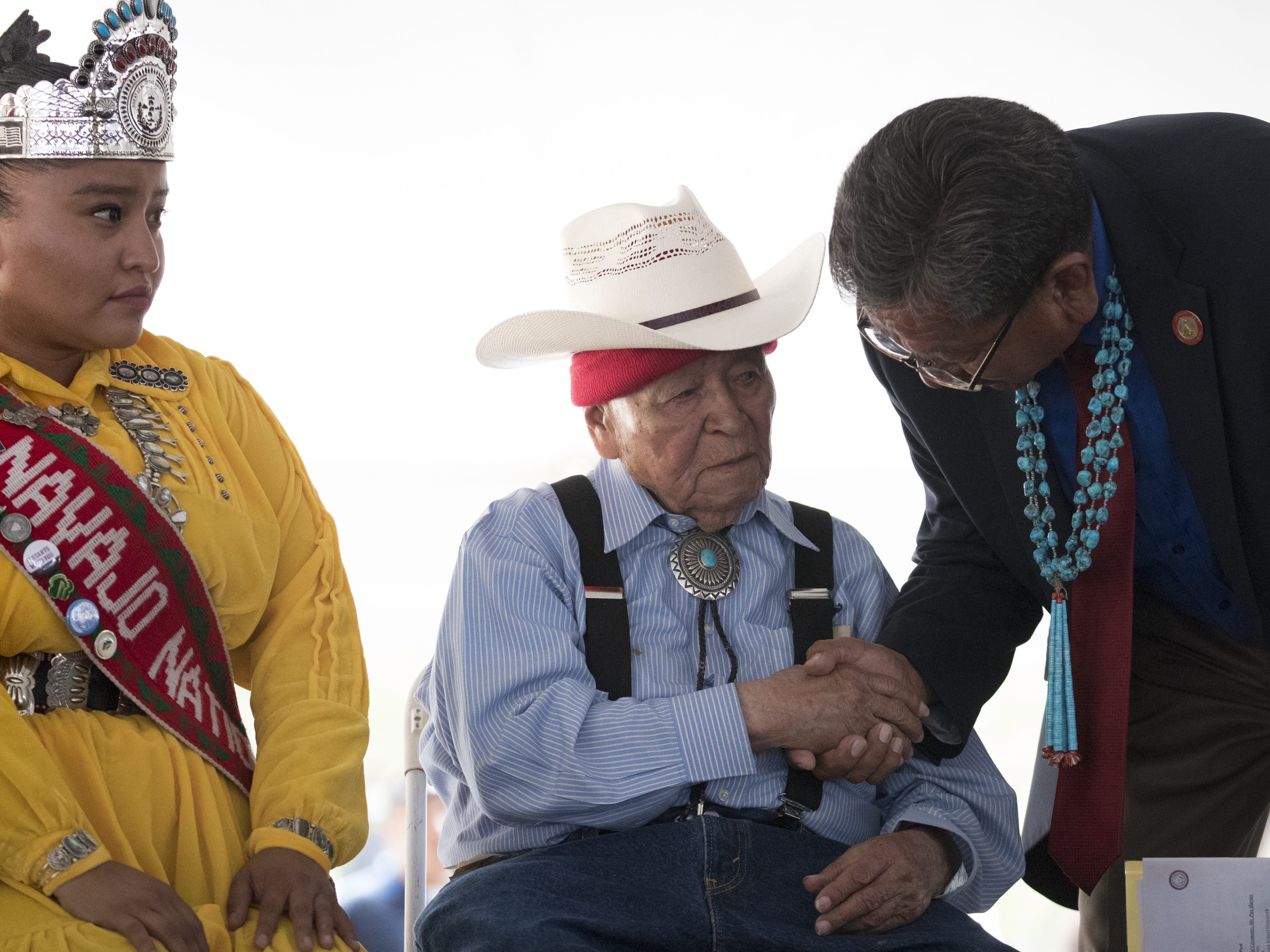Navajo Code Talker John Pinto (center) talks with Navajo Nation President Russell Begaye (right) during the Navajo Nation Code Talkers Day ceremony on Aug. 14, 2018, at the Veterans Memorial Park in Window Rock.