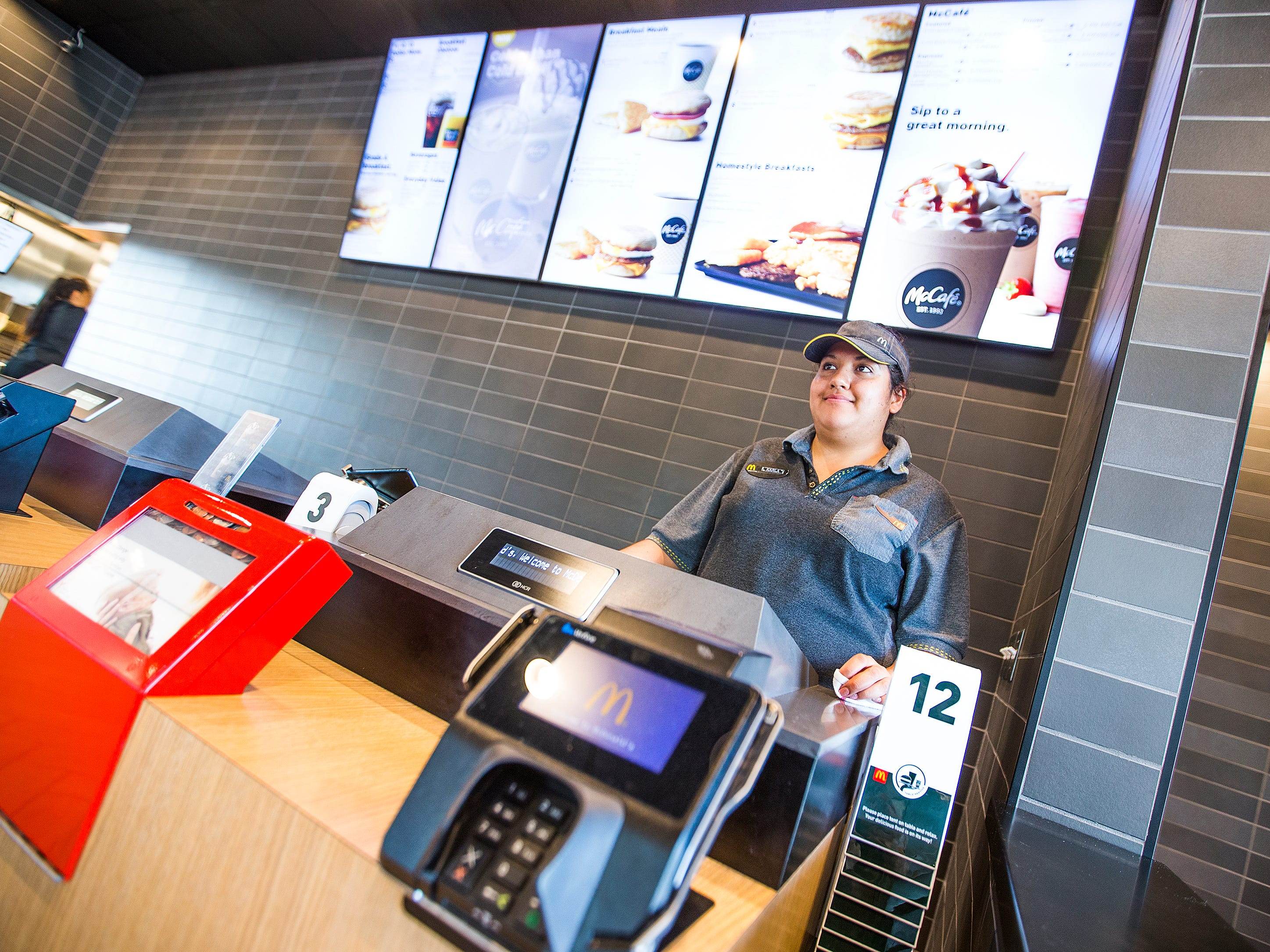 Cashier Karla Castrejon waits for a customer at the McDonald's at 32nd Street and Indian School Road in Phoenix.