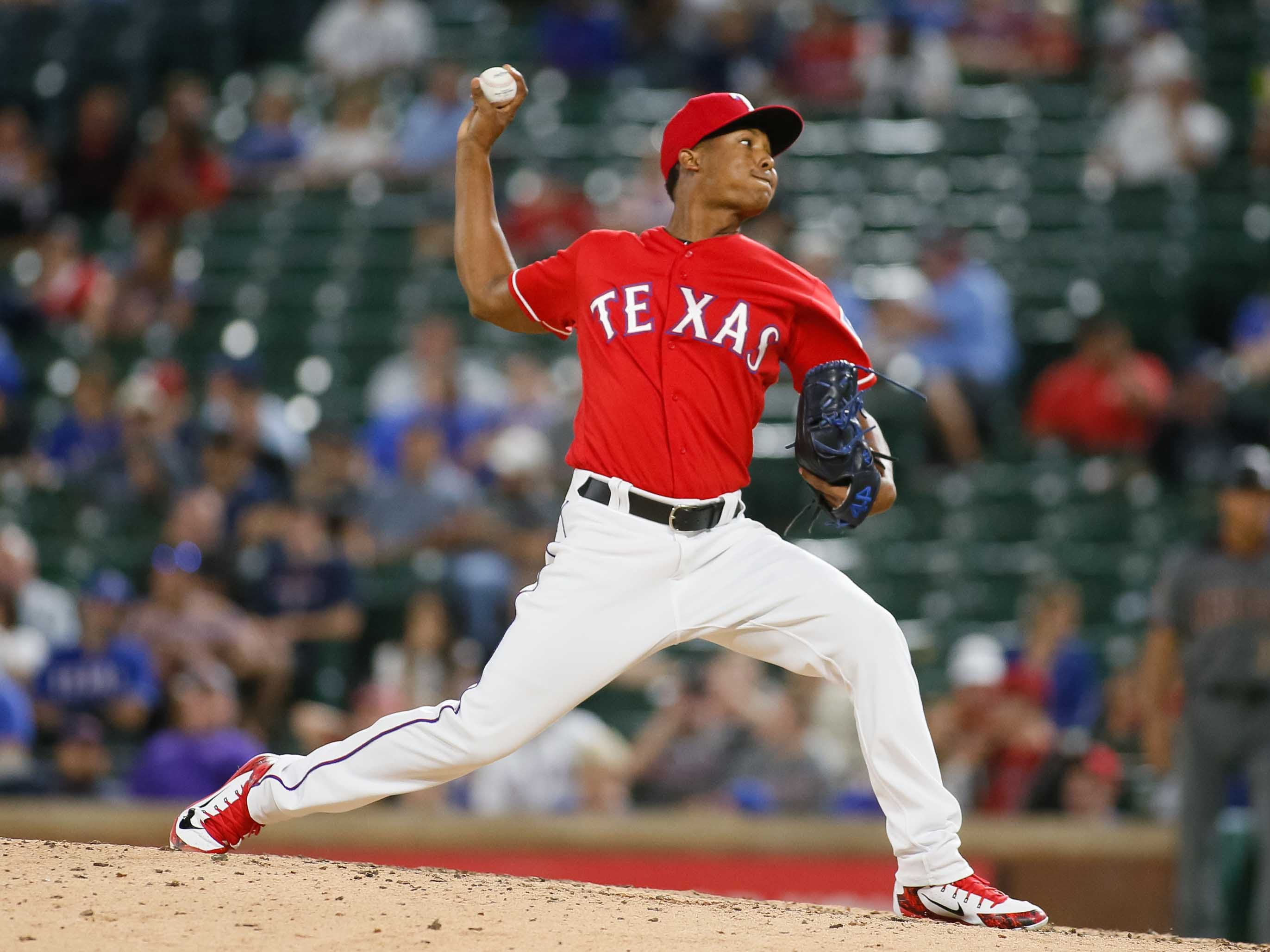 Aug 13, 2018; Arlington, TX, USA; Texas Rangers relief pitcher Jose Leclerc (62) throws in the ninth inning against the Arizona Diamondbacks at Globe Life Park in Arlington. Mandatory Credit: Ray Carlin-USA TODAY Sports