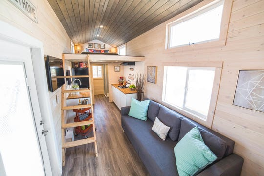 A view of the living, kitchen and bedroom space in the Beers' tiny home.