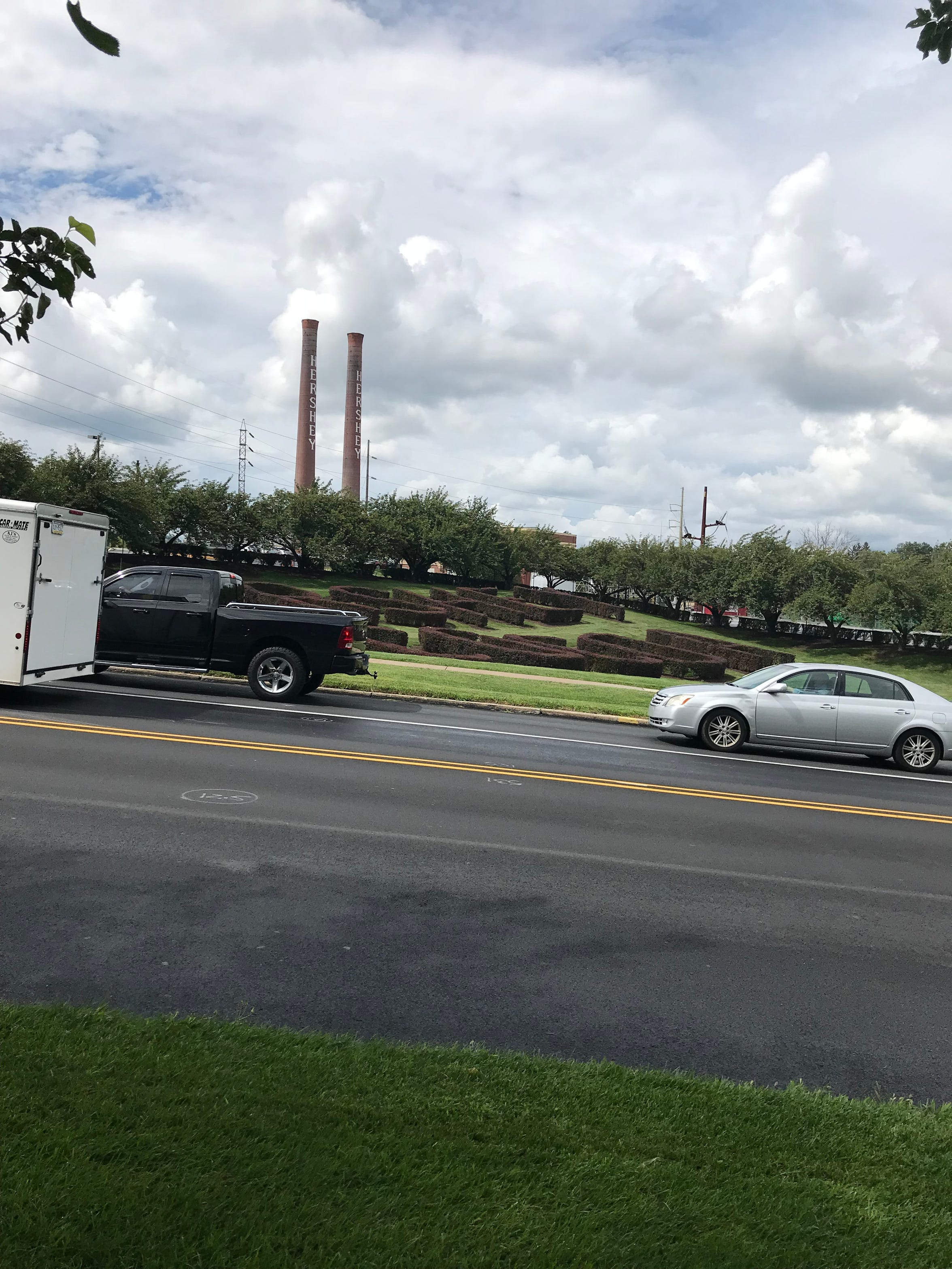 The iconic Hershey smokestacks and hedges, pictured on August 14, 2018.