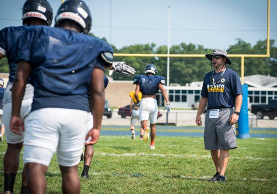 Port Huron Northern coach Larry Roelens directs the team in a warmup Tuesday, Aug. 14, 2018, during a practice at Port Huron Northern High School.
