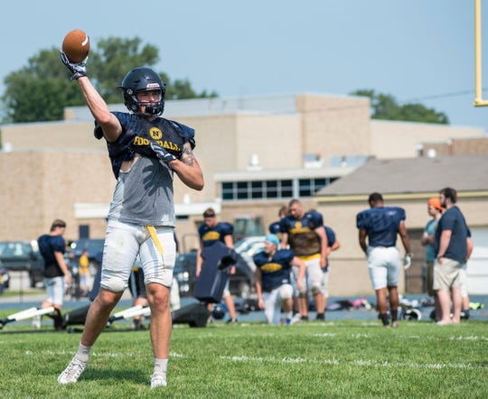 Port Huron Northern defensive lineman Braiden McGregor throws a pass during practice Tuesday, Aug. 14, 2018, at Port Huron Northern High School.