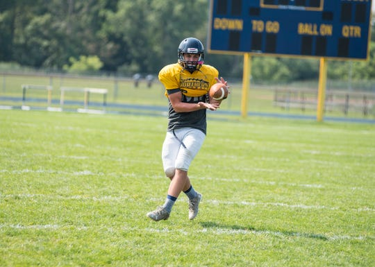 Port Huron Northern fullback Brady Chicone catches a pass during practice Tuesday, Aug. 14, 2018, at Port Huron Northern High School.