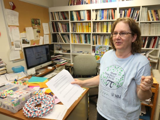 Math professor Lauren Rose, describes a game she uses to teach math in her office at Bard College on August 10, 2018. Rose started the Bard Math Circle in 2008 which includes a math camp for middle school aged girls.