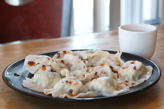Shrimp, egg and chive dumplings with a cup of green tea at Palace Dumplings in Wappingers Falls on August 9, 2018.