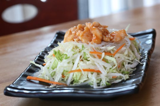 The flavor salad at Palace Dumpling in Wappingers Falls on August 9, 2018. The flavor salad is made with shredded cabbage, carrots, bean noodles and topped with chicken.