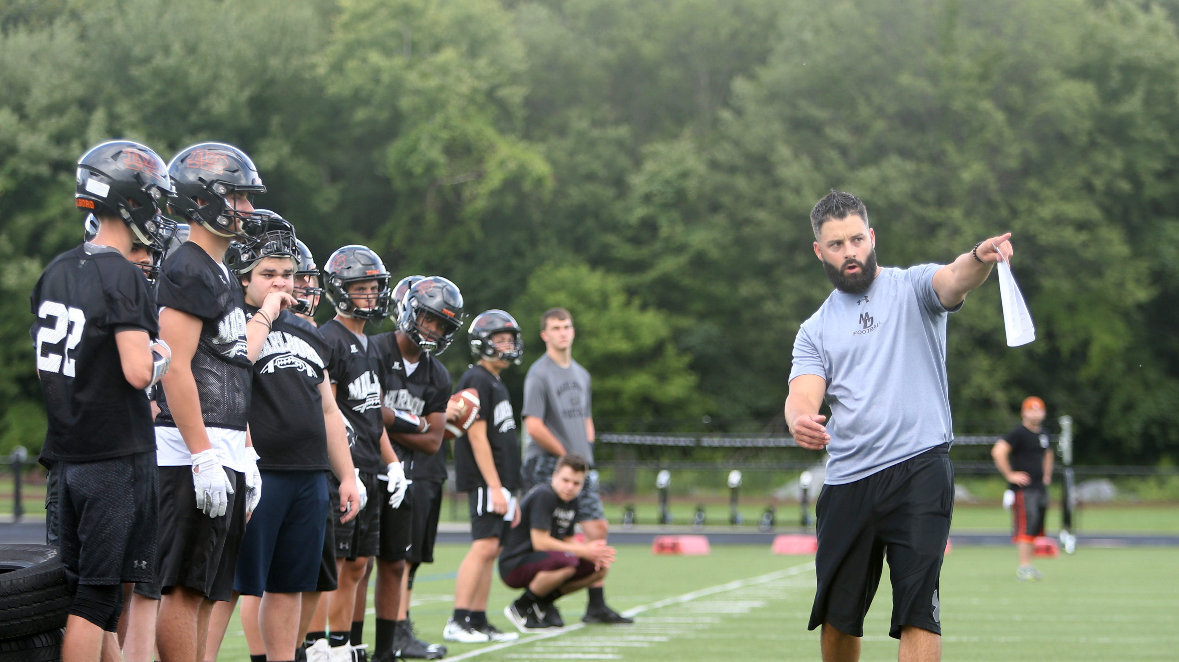 Football head coach, Bryan Beck explains a drill to his players during Tuesday's pre-season practice at Marlboro High School on August 14, 2018.