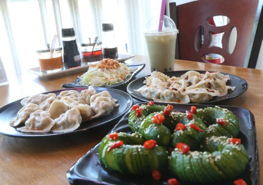 Clockwise from left, pork & scallion dumplings, the flavor salad, bubble green tea, shrimp, egg & chive dumplings and layered cucumber salad and at Palace Dumpling in Wappingers Falls on August 9, 2018.
