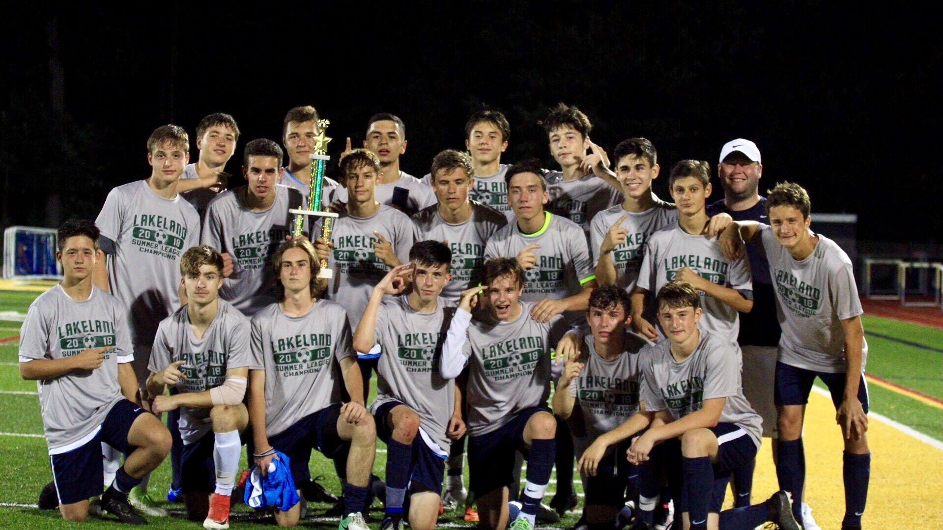 The John Jay boys soccer team poses after taking first place in the Lakeland soccer summer league in July.