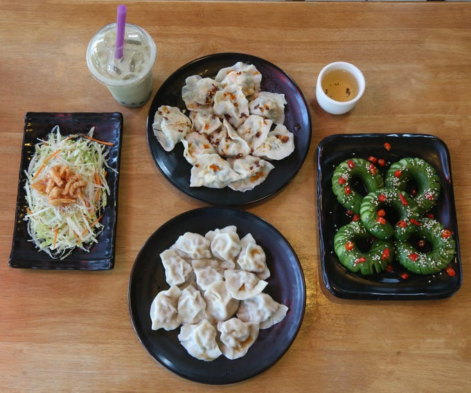 Clockwise from left, the flavor salad, bubble green tea, shrimp, egg & chive dumplings, green tea, layered cucumber salad and pork & scallion dumplings at Palace Dumplings in Wappingers Falls on August 9, 2018.
