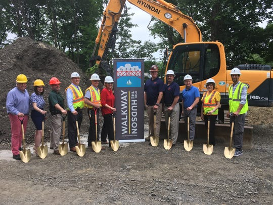 Officials stand for a photo at a breaking ground ceremony for the planned Dutchess County Welcome Center at Walkway Over the Hudson State Historic Site.