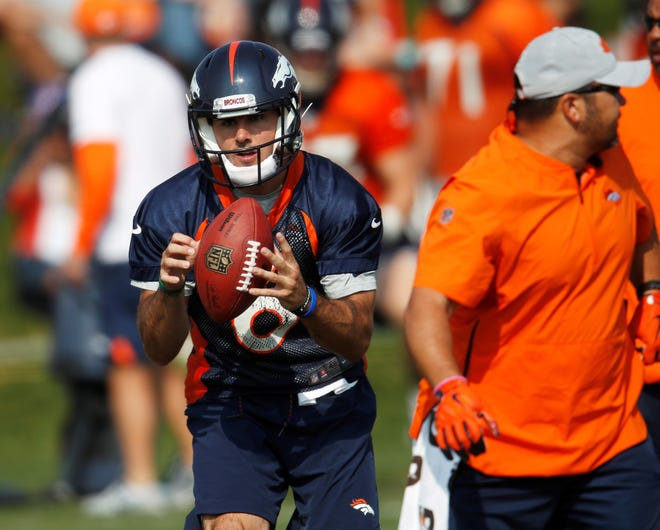 Denver Broncos quarterback Chad Kelly takes part in drills during training camp Tuesday in Englewood, Colorado. The former Red Lion High School player was promoted to Denver's No. 2 QB on Monday. (AP Photo/David Zalubowski)