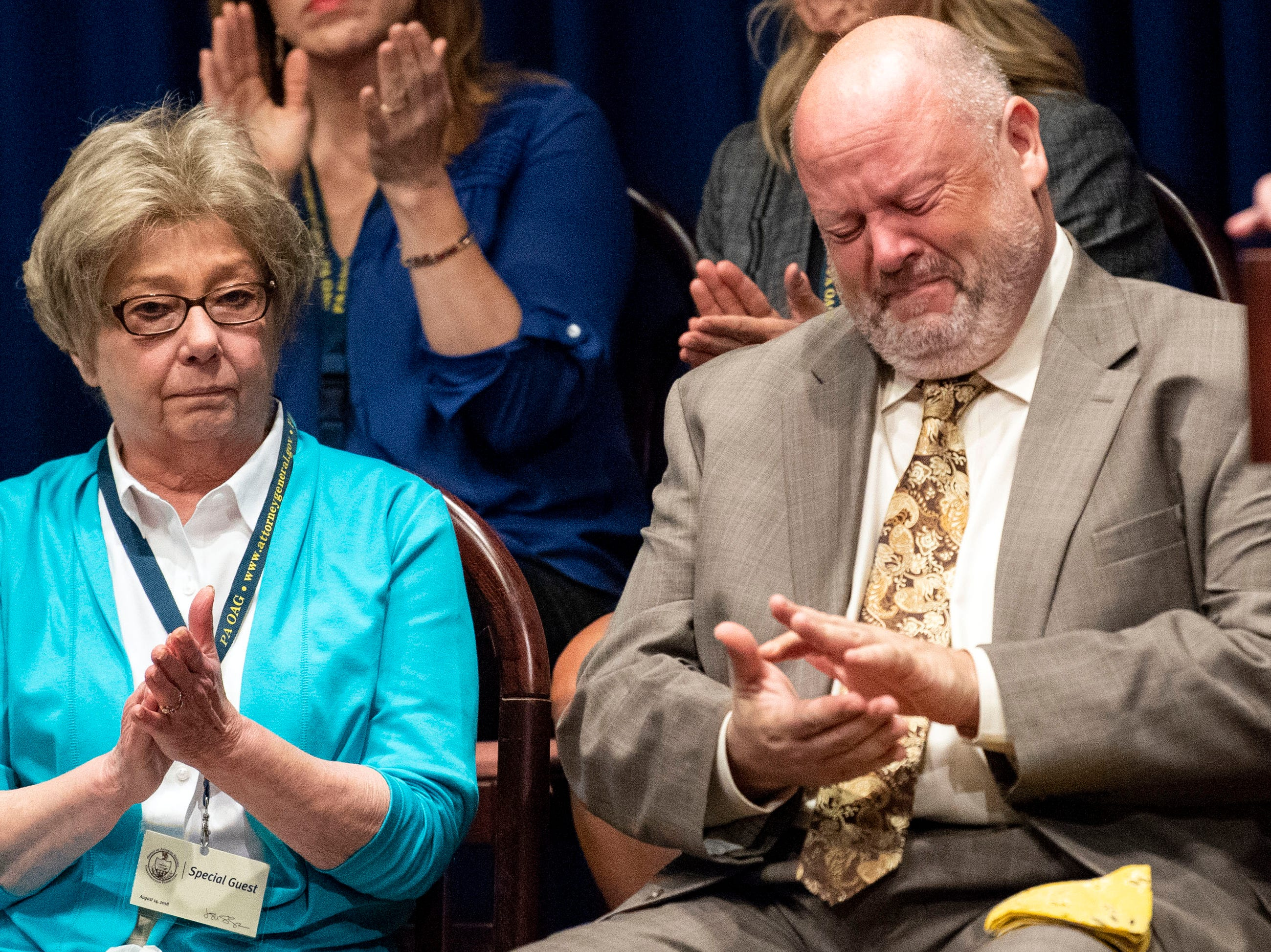 James Faluszczuk, right, who was abused in the Erie diocese, cries as Attorney General Josh Shapiro outlined the findings of the grand jury investigation into six catholic diocese in Pennsylvania, Tuesday, August 14, 2018. The grand jury's report detailed child sexual abuse and coverup by more than 300 clergy.