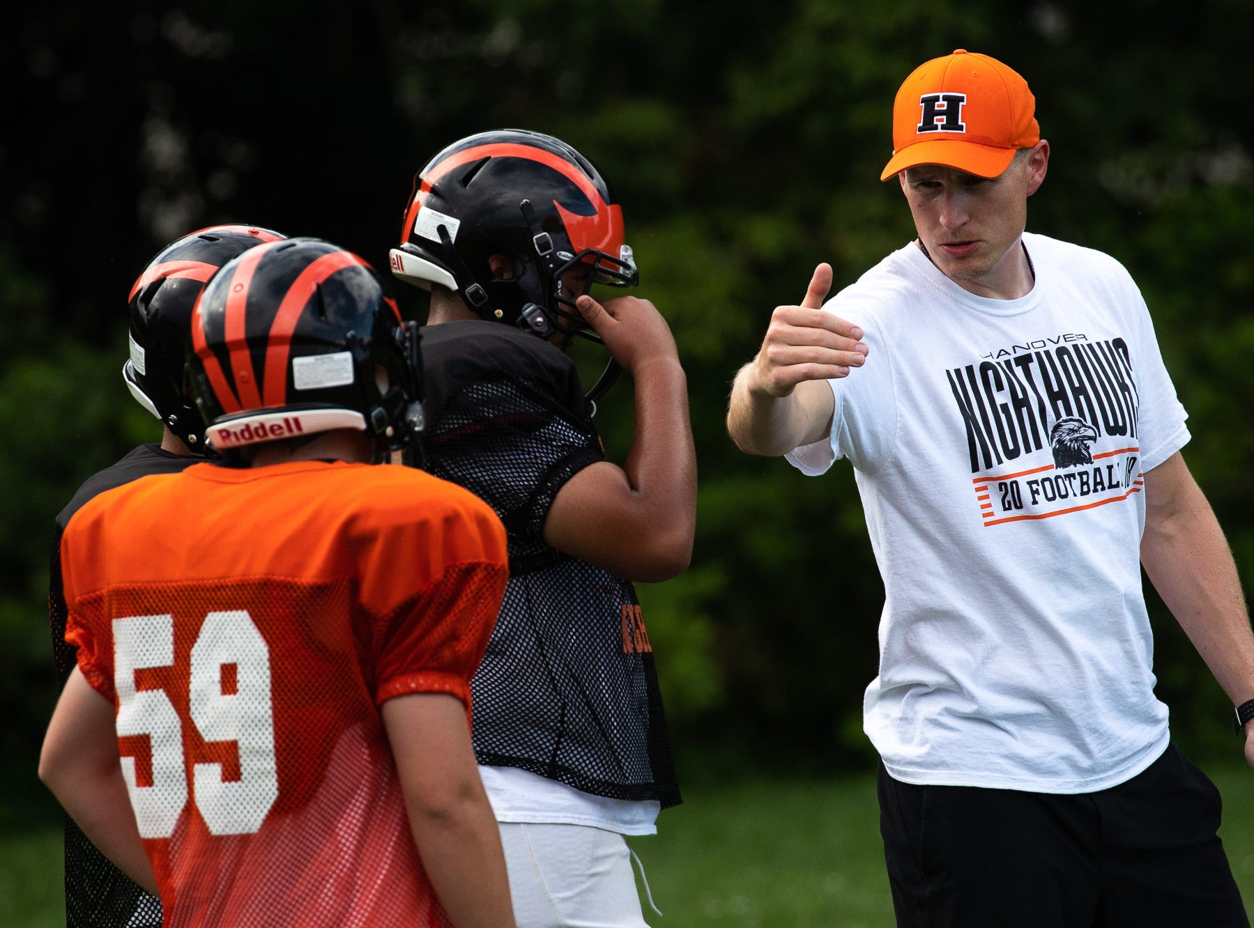 Hanover High School football head coach Brandon Bishop guides members of his team during practice on the first day of fall sports practice, Monday, Aug. 13, 2018, at the Sheppard-Meyers Stadium.