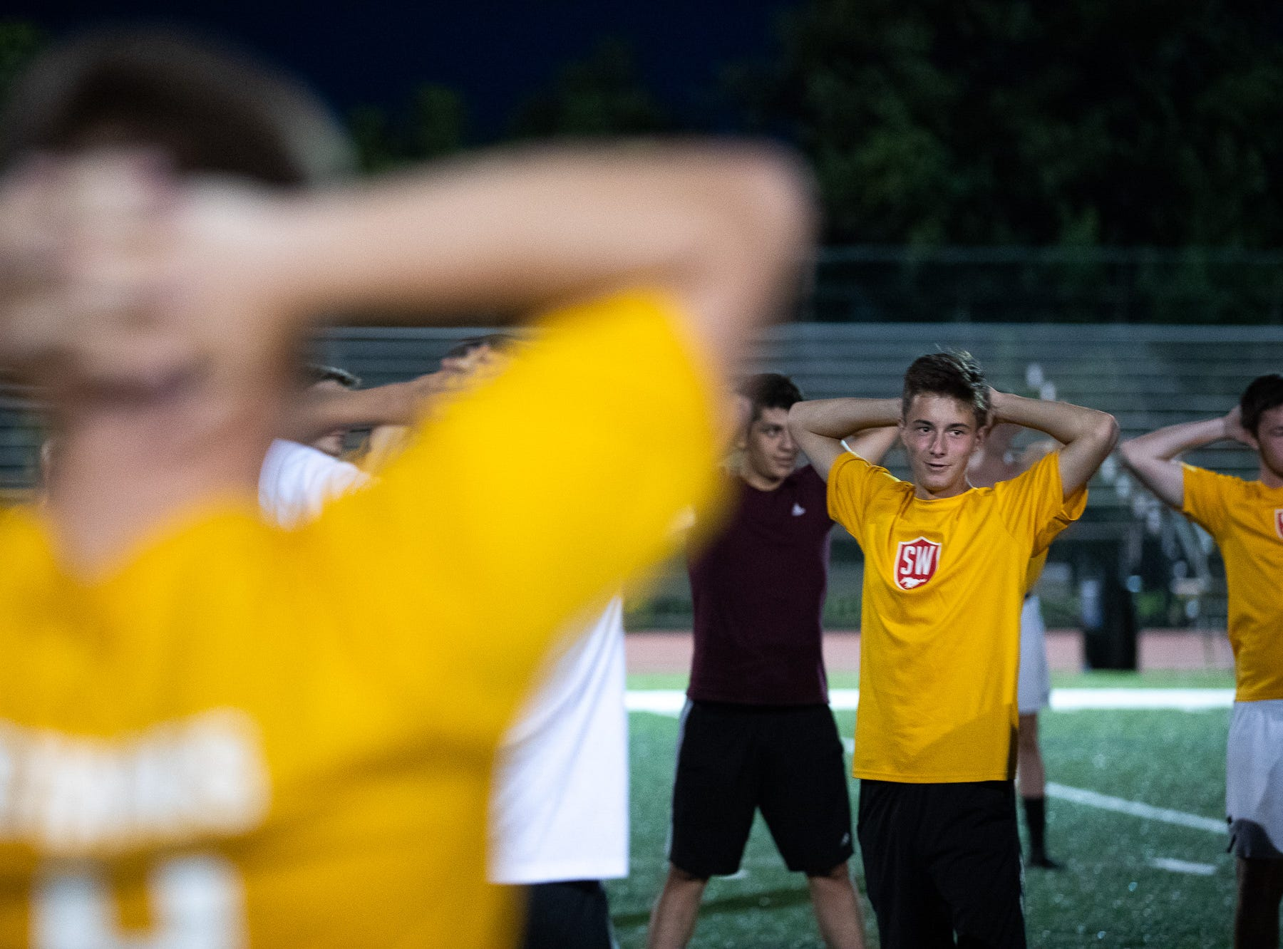 The South Western Boys Soccer team scretch on the first day of fall sports practice, Monday, Aug. 13, 2018, at South Western High School.