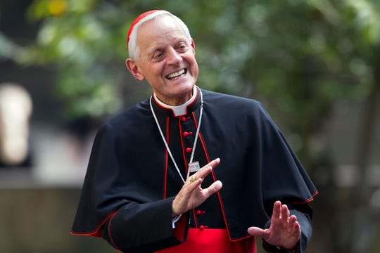 Cardinal Donald Wuerl, archbishop of Washington, waves after he and Pope Francis arrived at the Apostolic Nunciature, the Vatican's diplomatic mission in the heart of Washington, in 2015.