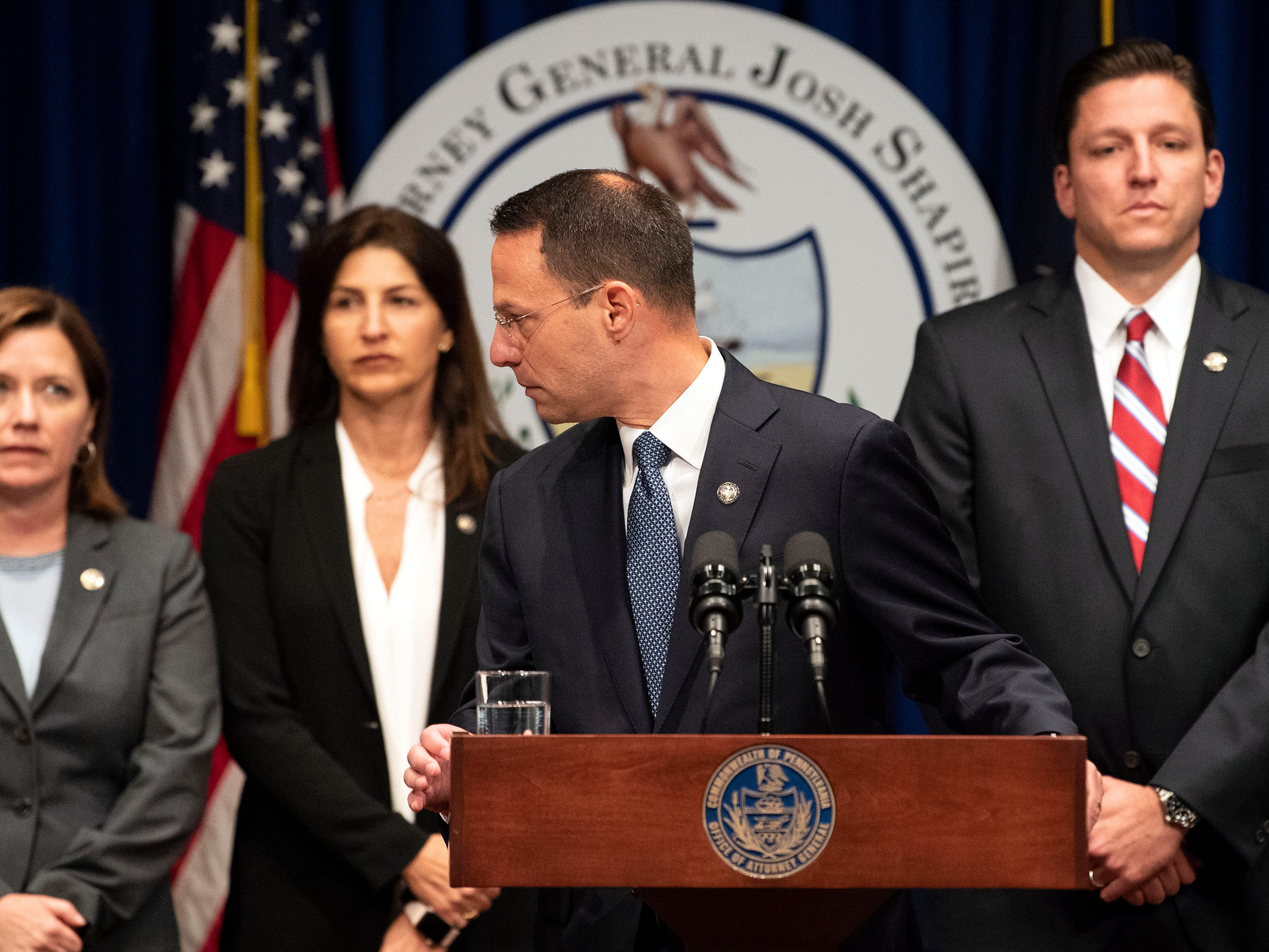 Attorney General Josh Shapiro acknowledges survivors prior to outlining the findings of the grand jury investigation into six catholic diocese in Pennsylvania on Tuesday, August 14, 2018. The grand jury's report detailed child sexual abuse and coverup by more than 300 clergy.