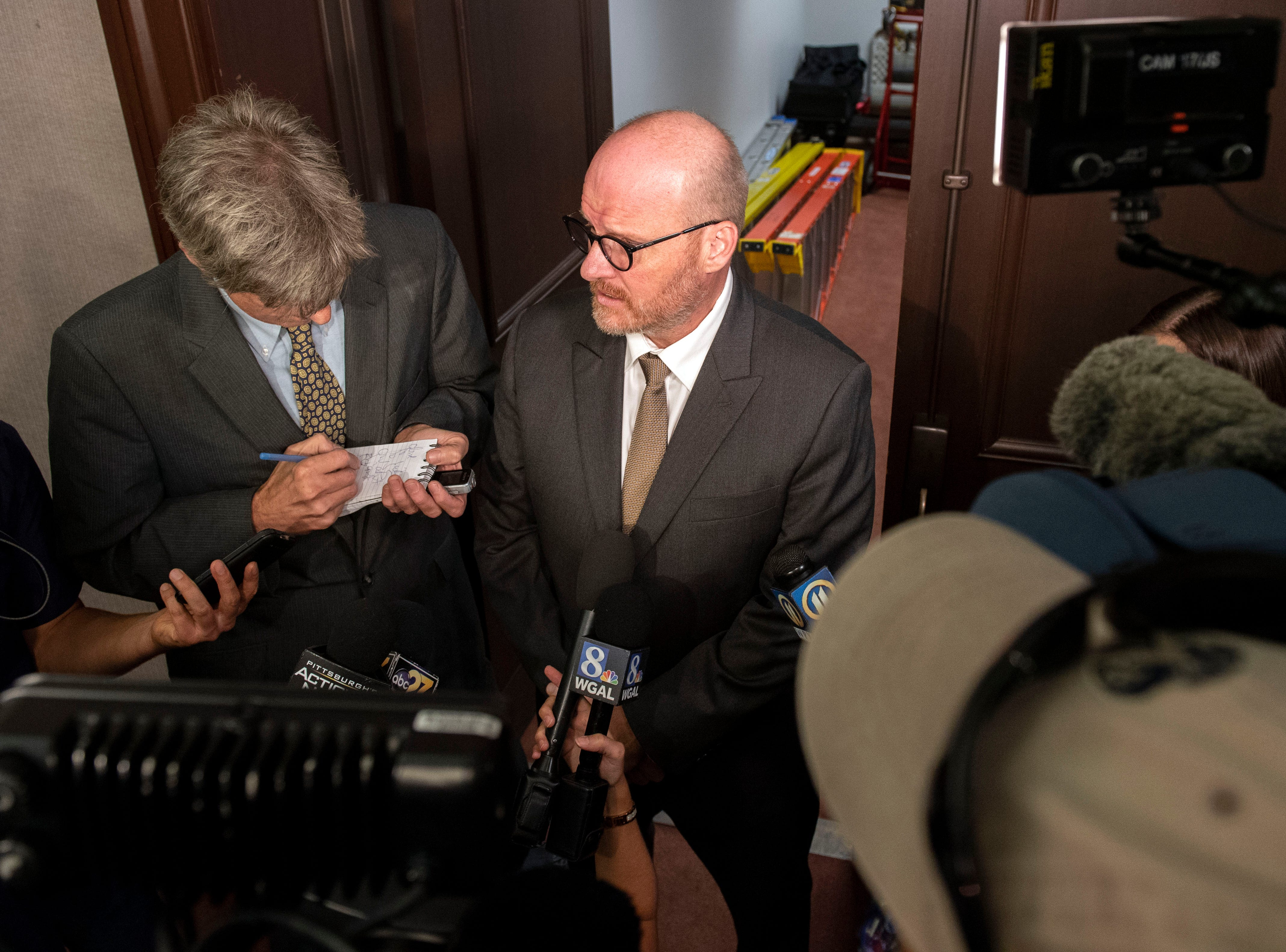 'I have closure,' said Shaun Daugherty, a survivor of sexual abuse by a priest, speaks to media after Attorney General Josh Shapiro outlined the findings of the grand jury investigation into six catholic diocese in Pennsylvania, Tuesday, August 14, 2018. The grand jury's report detailed child sexual abuse and coverup by more than 300 clergy.