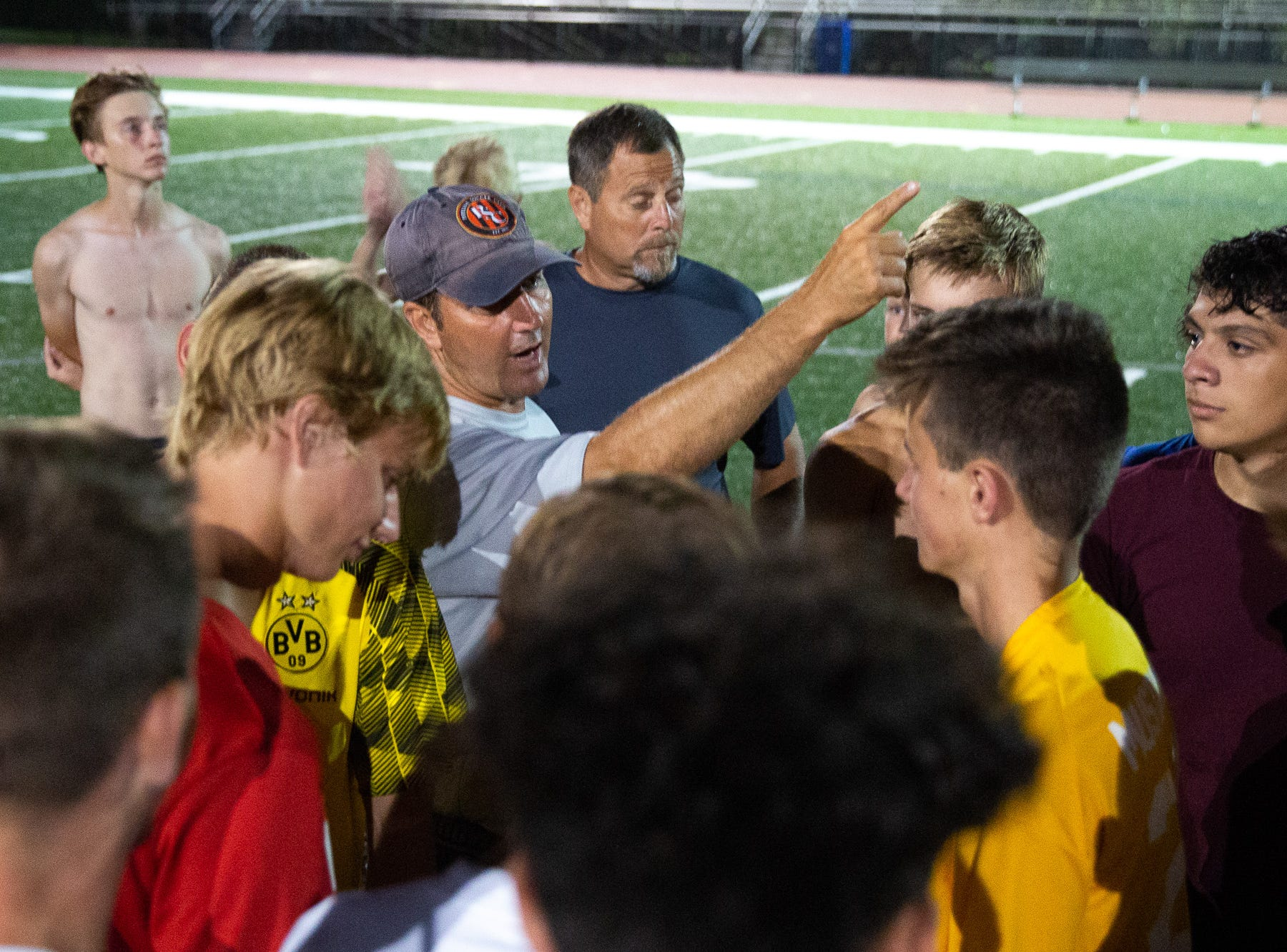 South Western boys soccer head coach Slater speaks to his team after practice on the first day of fall sports practice, Monday, Aug. 13, 2018, at South Western High School.