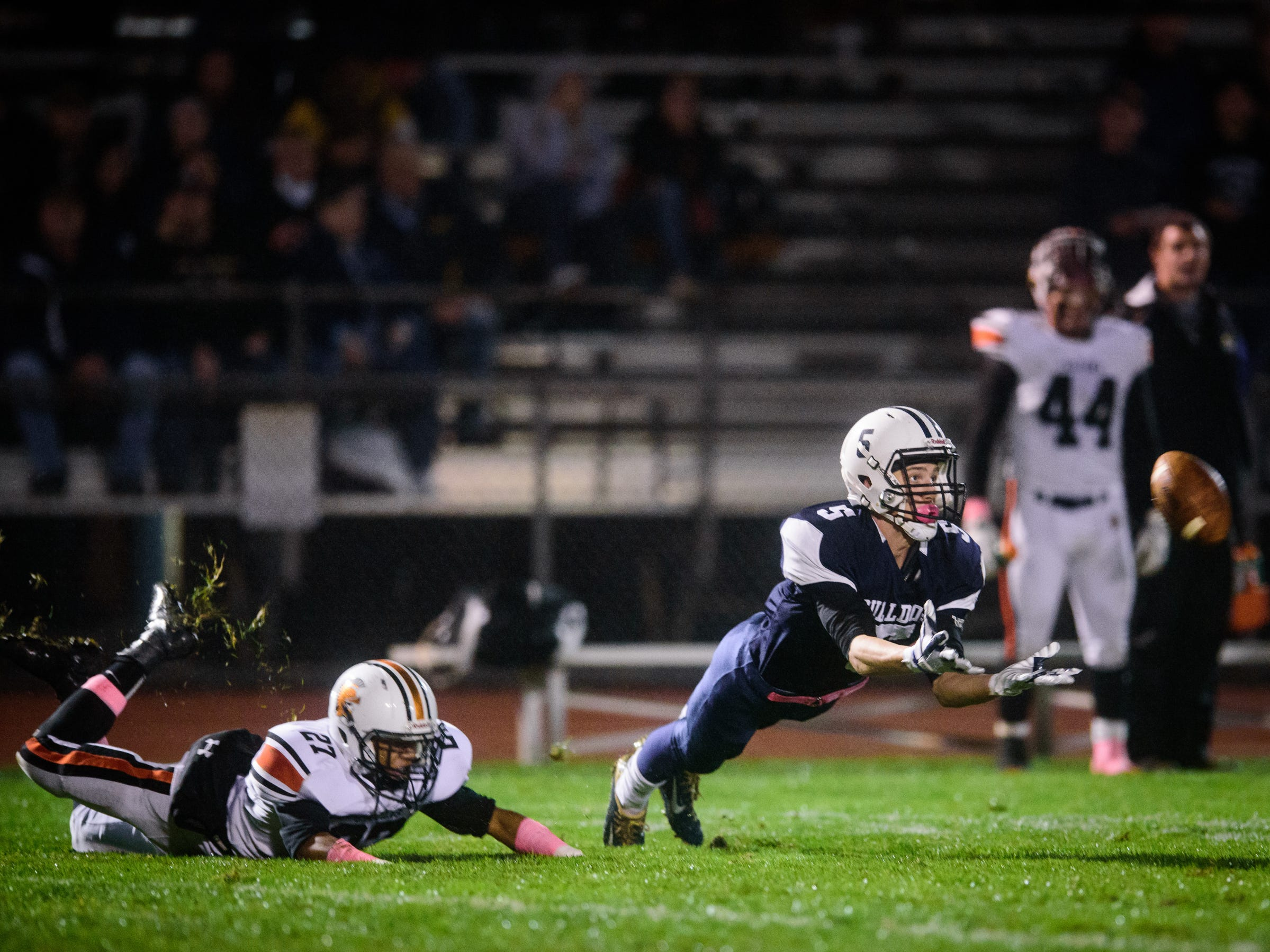 West York's Andrew LaManna (5) stretches out but comes up short of a reception against York Suburban in a YAIAA football game on Friday, Oct. 13, 2017. West York won 34-0.