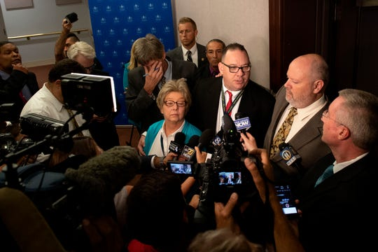 Survivors of priest abuse Juliann Bortz, from left, Jim VanSickle and James Faluszczuk speak about their feeling of relief spawning from the press conference, Tuesday, August 14, 2018. Attorney General Josh Shapiro outlined the findings of the grand jury investigation into six catholic diocese in Pennsylvania. The grand jury's report detailed child sexual abuse and coverup by more than 300 clergy.