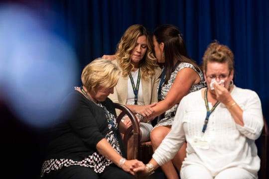Survivors comfort each other while Attorney General Josh Shapiro outlined the findings of the grand jury investigation into six catholic diocese in Pennsylvania, Tuesday, August 14, 2018. The grand jury's report detailed child sexual abuse and coverup by more than 300 clergy.