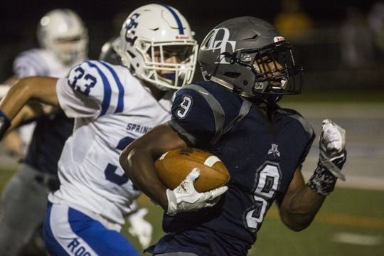 Spring Grove's Patrick Anderson (33) gives chase to Dallastown's Nyzair Smith in a Wildcat victory last September. Anderson's standout performance on and off the field helped him earn the Quarterback Club of York's annual scholarship.