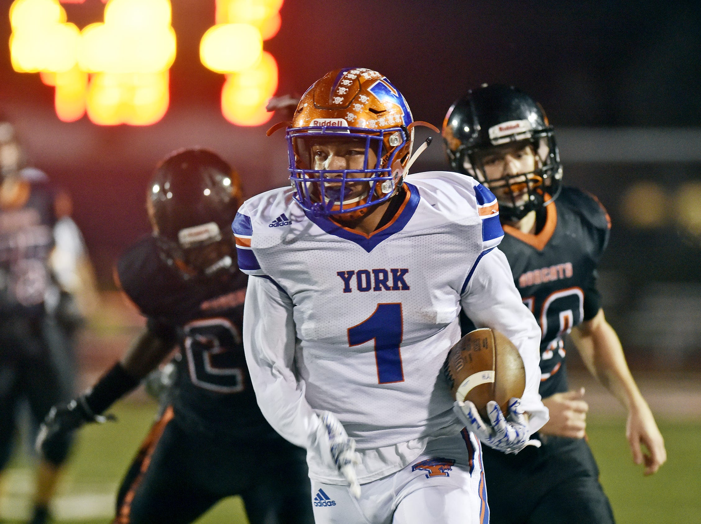 York High's Dayjure Stewart carries the ball against Northeastern in the first half of a YAIAA football game Friday, Oct. 13, 2017, at Northeastern. York High defeated Northeastern 55-6.