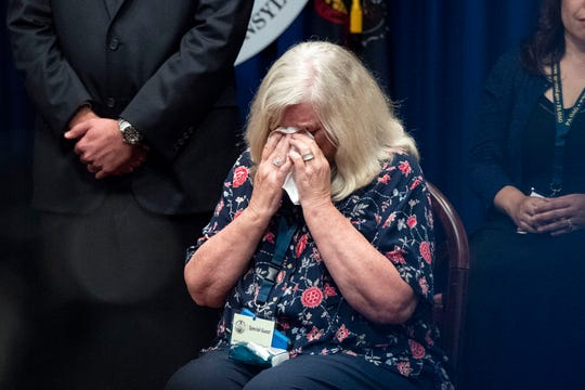 Judy Deaven, of Harrisburg, weeps as Attorney General Josh Shapiro outlined the findings of the grand jury investigation into six catholic diocese in Pennsylvania on Aug. 14, 2018. The grand jury's report detailed child sexual abuse and coverup by more than 300 clergy.