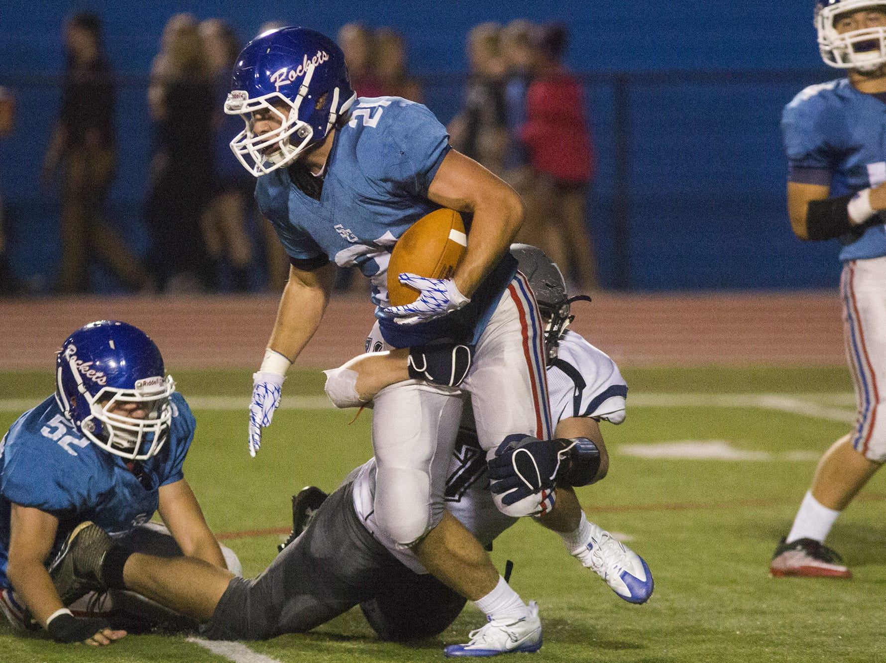 Dallastown's Raymond Christas, bottom center, tackles Spring Grove's Ryan Daugherty behind the line of scrimmage.