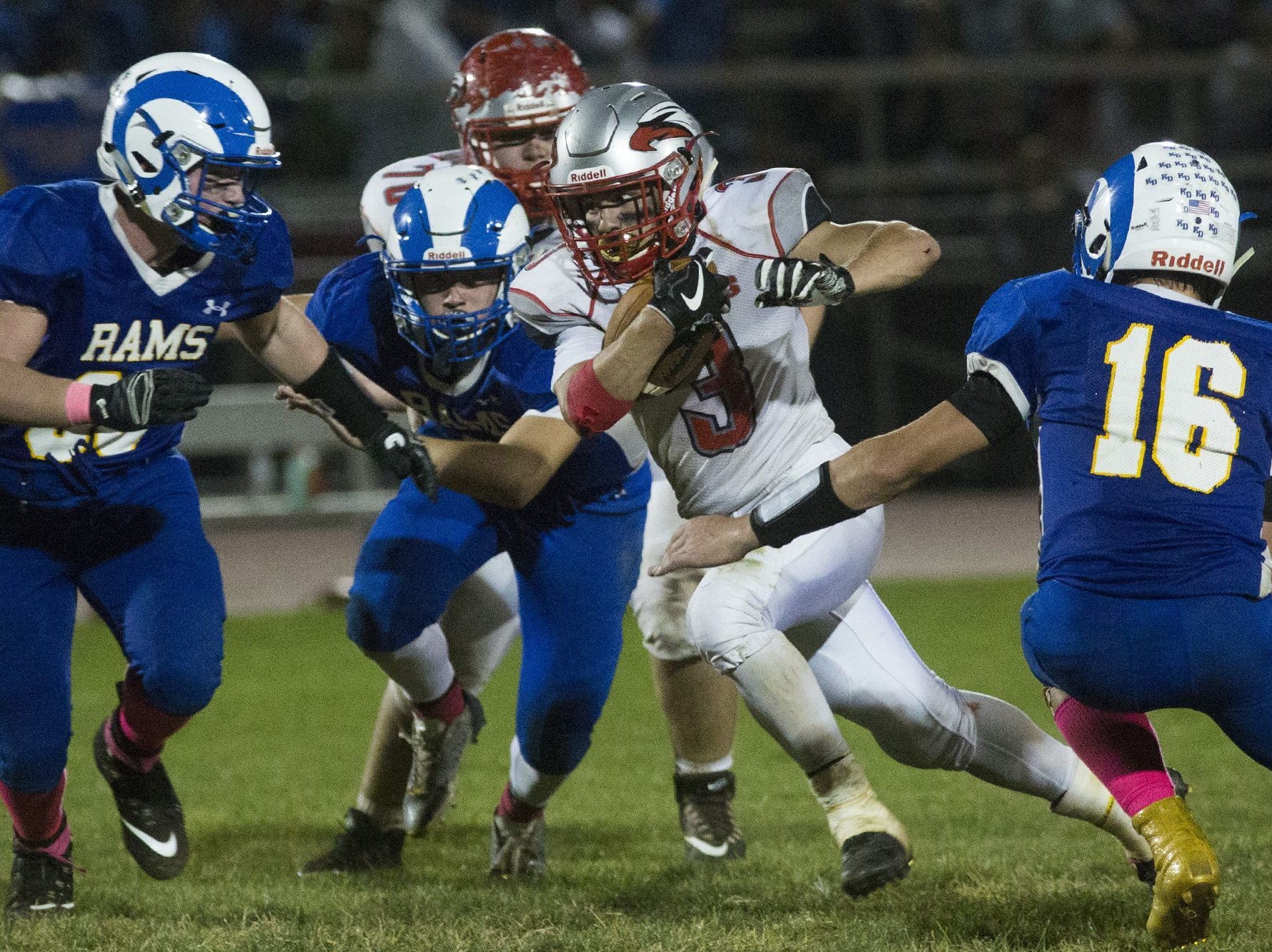 Dover?s Derek Arevalo carries the ball against Kennard-Dale  on Friday. He had 128 combined yards and two touchdowns