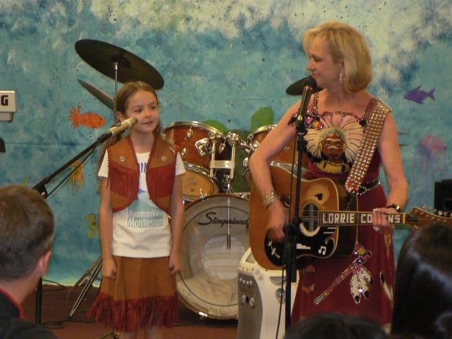 Lorrie Collins performs with one of her granddaughters at the Mountain View Montessori School in Reno.