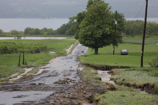 Rhodes Rd., in Lodi, NY has portions of it washed away and a standing pool of water.
