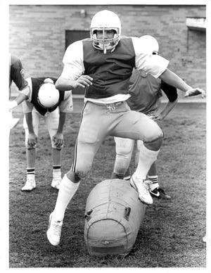 Bill Young participates in a 1984 football practice at East Rochester. Young made AGR in 1984.