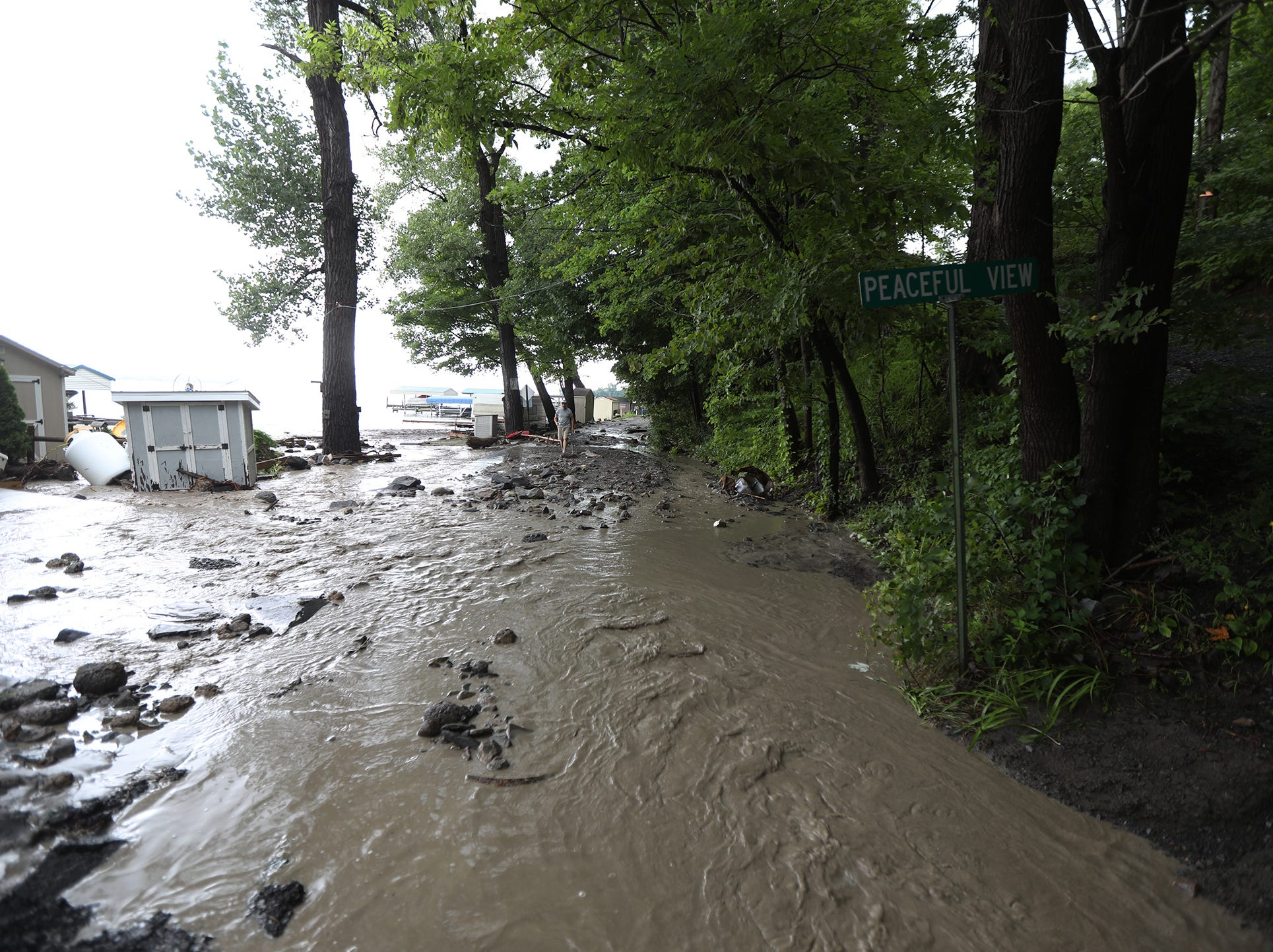 Several portions of Lower Lake Road in Lodi were washed away after heavy rain caused flooding and washing away at Lodi Point, New York on Tuesday, August 14, 2018.