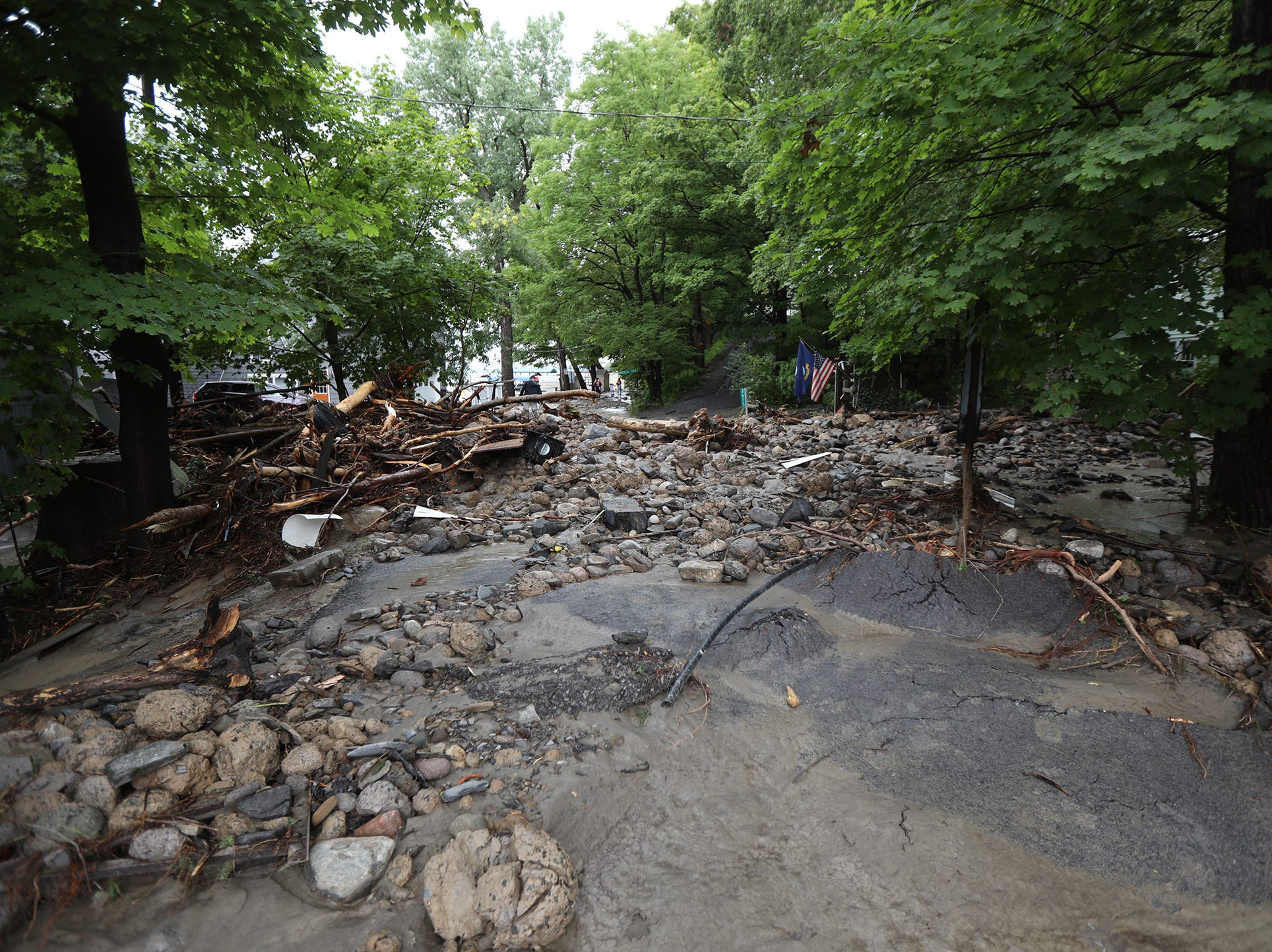 For several hours a portion of Lower Lake Road near Shaw Road was impassable after heavy rain caused flooding and washing away at Lodi Point, New York on Tuesday, August 14, 2018.