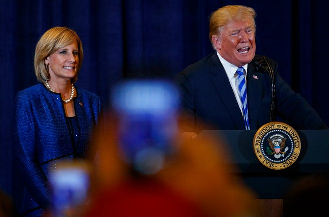 President Donald Trump, joined by Rep. Claudia Tenney, R-N.Y., speaks Aug. 13, 2018, at a joint fundraising committee reception in Utica, New York.