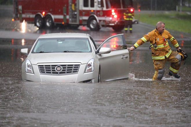 Flooding on Garnsey Rd under 490