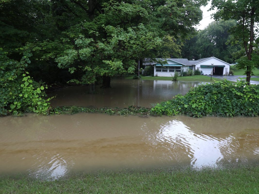 Fortunately this home near the creek is not completely surrounded by water