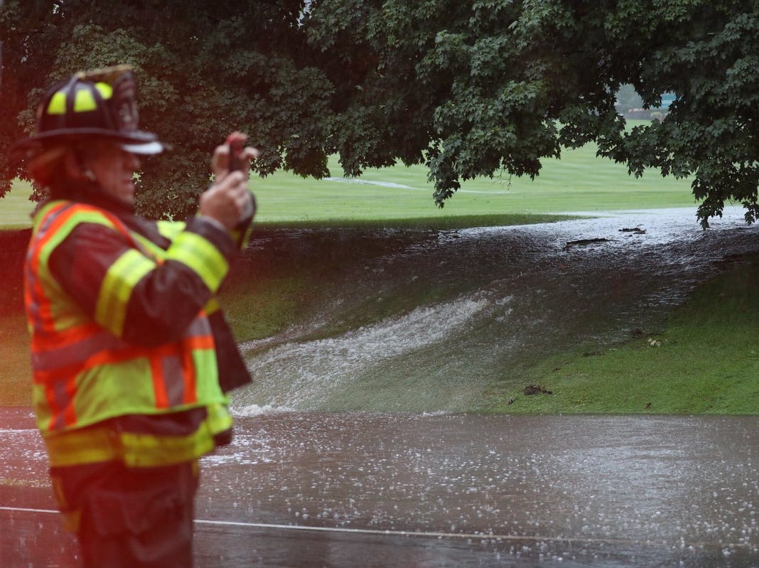 Waterfalls created by flooding on Garnsey Road.