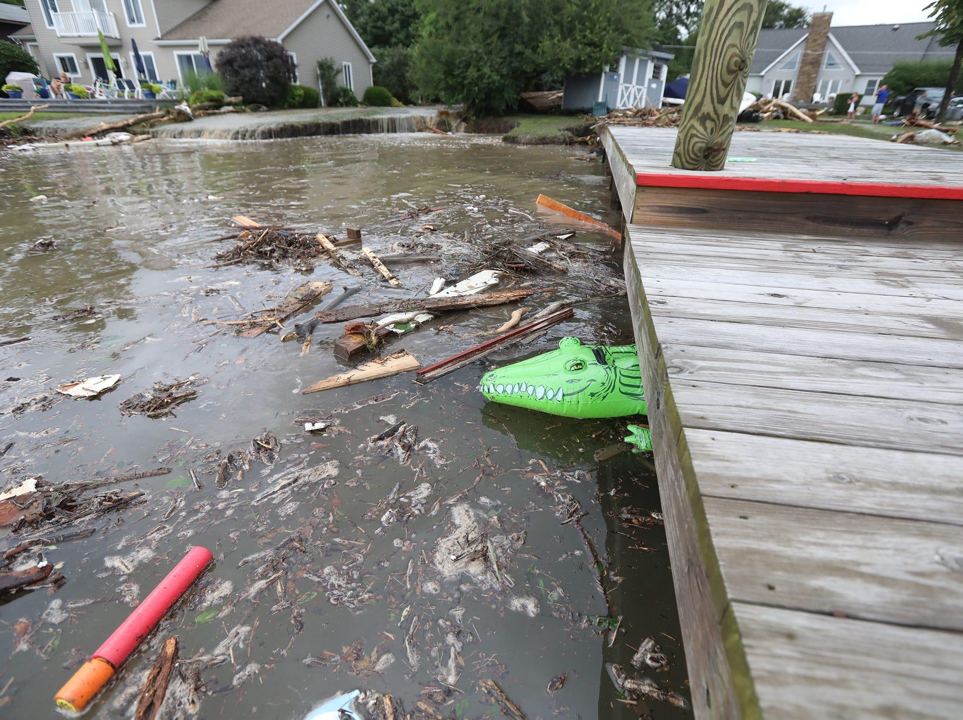 Some of people's possessions and debris were jammed under docks along Seneca Lake.