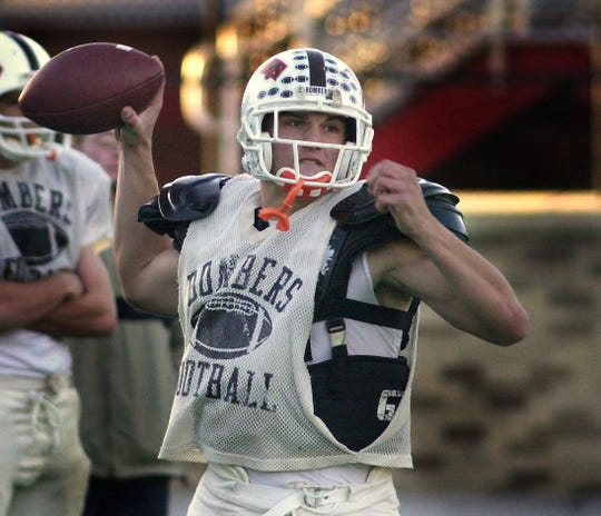 East Rochester quarterback Ron Whitcomb during a 2001 practice. Whitcomb went on to play at the University of Maine and coach college football at Old Dominion.
