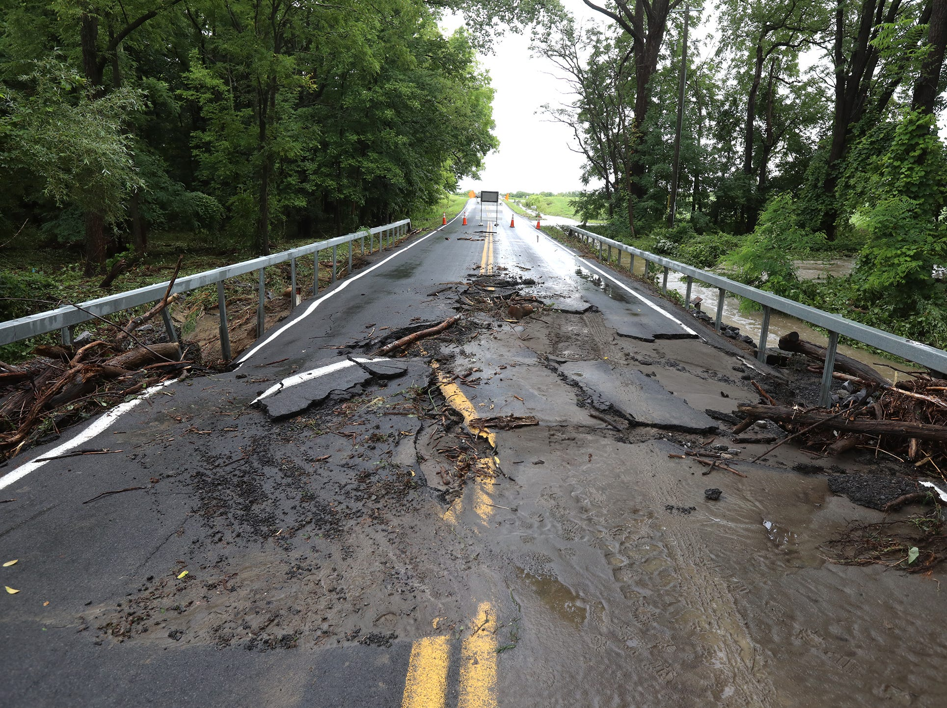 County Road 131 was damaged with portions of it washed away after heavy rain in Lodi, New York on Tuesday, August 14, 2018.